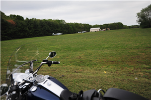 Motorcycle on grass landing strip